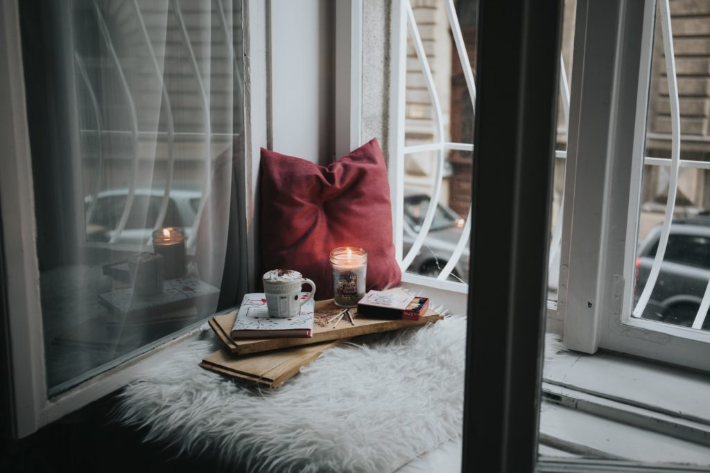 a collection of self-care tools like candles and coffee to improve your self-love love language
