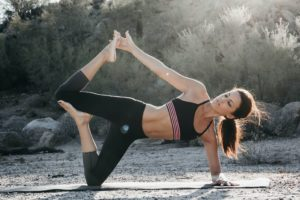 a beautiful woman doing yoga excercise to improve her life
